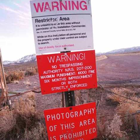 A warning sign greets you at the border of the infamous Area 51. Image credit: dnaindia.com